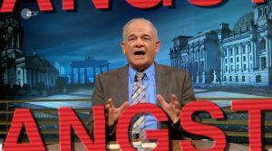 """Screenshot aus der ZDF-Sendung """"Peter Hahne"""", der den Moderator an seinem Tisch zeigt. Darunter ist, in rot, das Wort Angst zu erkennen."""