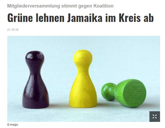 Schwarzes, gelbes und grünes Mensch-ärgere-dich-nicht-Männchen