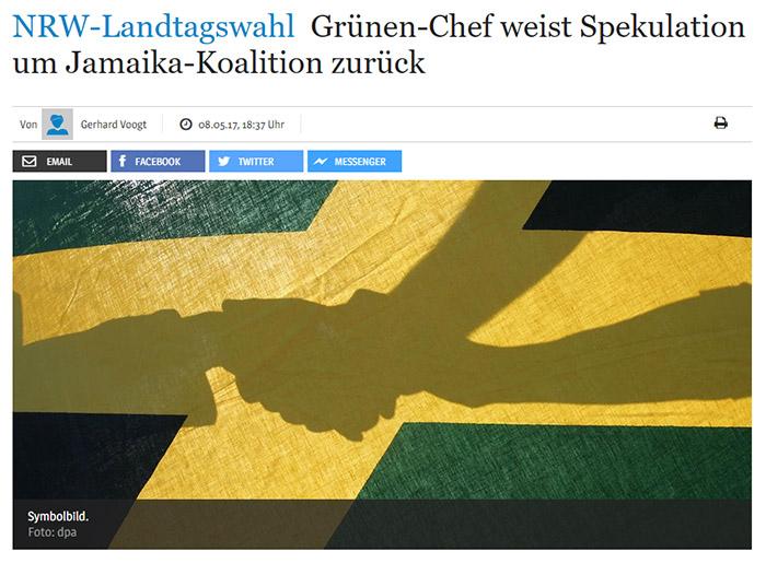 Jamaika-Flagge mit dem Schatten dreier Hände