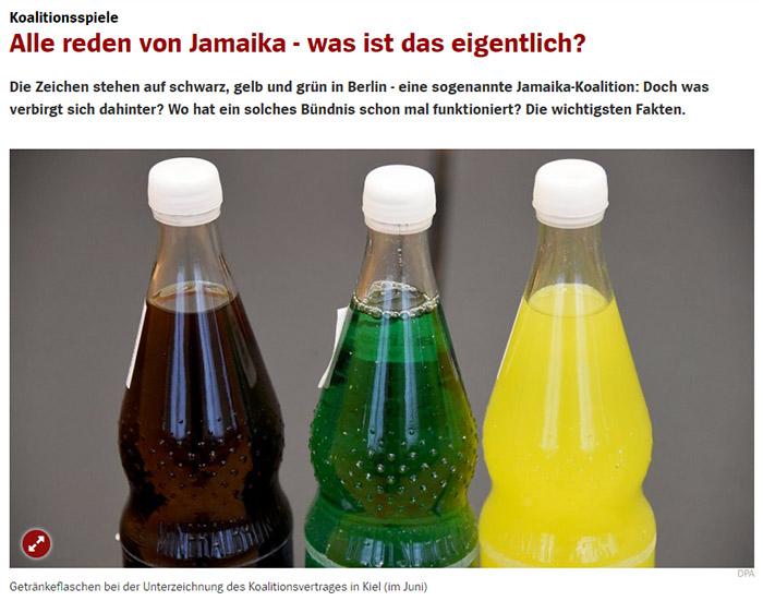 Drei Flaschen mit schwarzem, grünem und gelbem Getränk