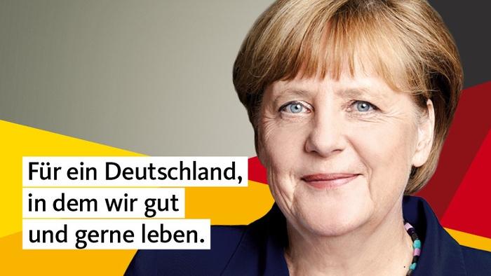 """Angela Merkel schaut lächelnd in die Kamera, hinter ihr schwarz-rot-goldenen Balken und daneben der Claim: """"Für ein Deutschland, in dem wir gut und gerne leben"""""""