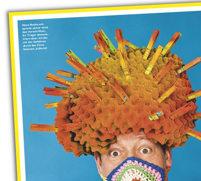 Eckart von Hirschhausen mit Kopfbedeckung in Form eines Virus