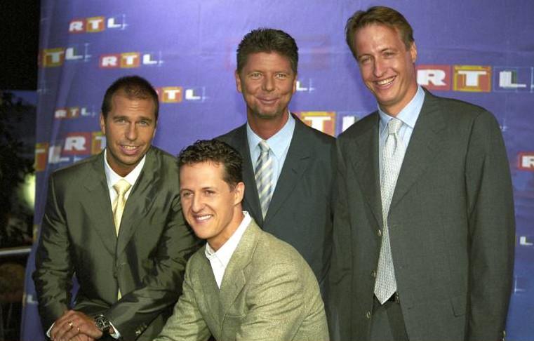 Kai Ebel, Michael Schumacher, Heiko Wasser und Florian König im August 2000 auf der Telemesse in Düsseldorf