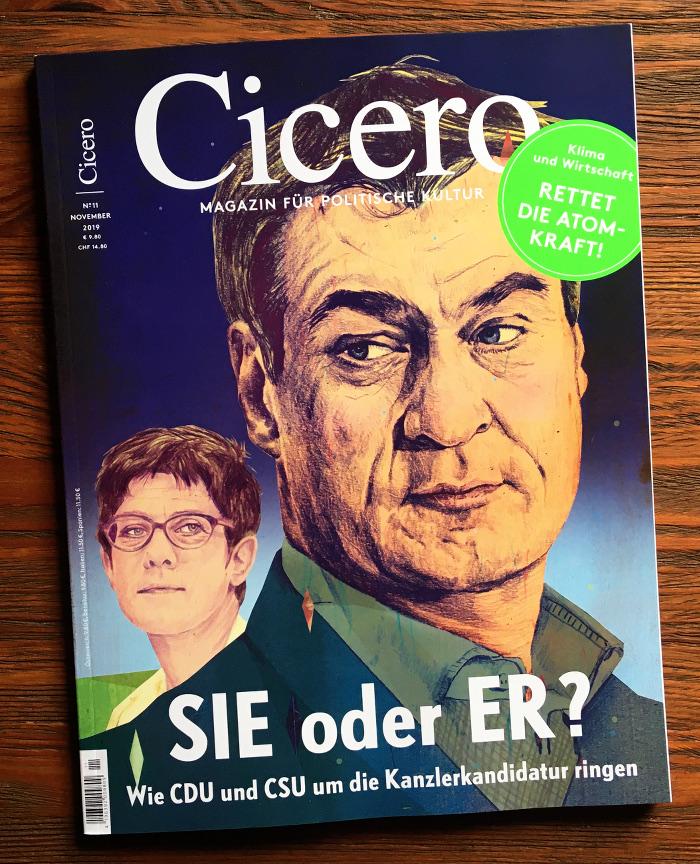 Großes gezeichnetes Konterfei von Markus Söder, dahinter klein: Annegret Kramp-Karrenbauer