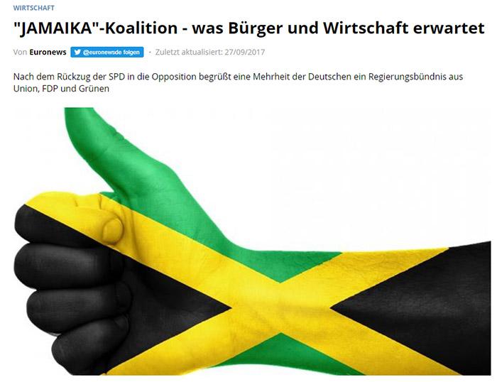 Arm mit aufgemalter Jamaika-Flagge
