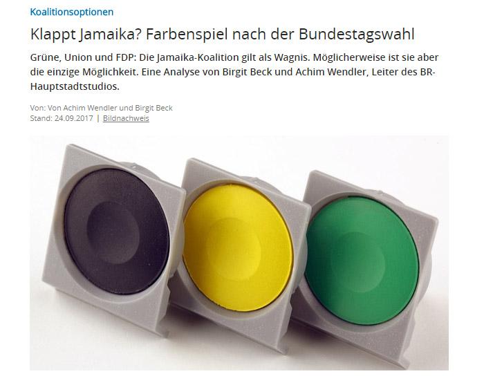 Schwarze, gelbe und grüne Farbe aus einem Farbkasten